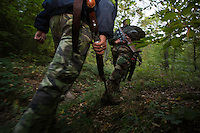 Romanian hunters during a driving hunt for Wild boar (Sus scrofa) in the forest area outside the village of Mehadia, Caras Severin, Romania.