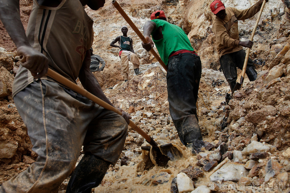 Workers mine cassiterite in Numbi in South Kivu Province in DRC on April 28, 2010. The long war, which had involved 9 African nations and claimed an estimated three million lives as a result of fighting or disease and malnutrition, was fuelled by the regions vast mineral wealth..Photo by Kuni Takahashi.