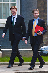 London, March 18th 2015. Members of the Cabinet gather at Downing street for their weekly meeting. PICTURED: Chief Secretary to the Treasury Danny Alexander, left, arrives at 10 Downing Street woth Deputy Prime Minister Nick Clegg.