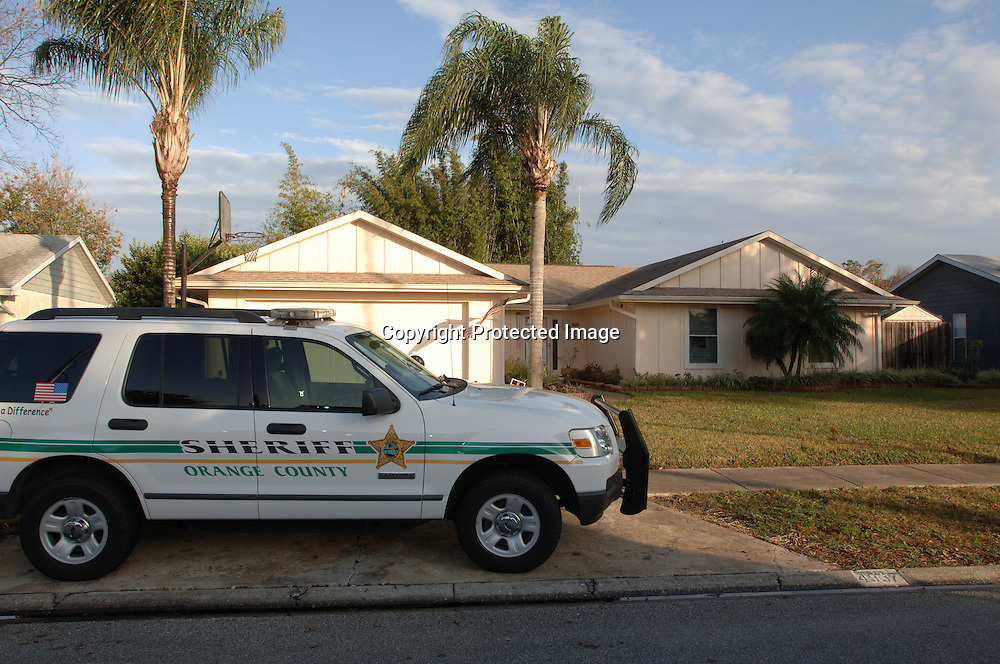 Orange County Sheriff's Department personnel guard the home of Casey Anthony after remains of missing three-year-old Caylee Anthony were found nearby on Dec. 11, 2008.