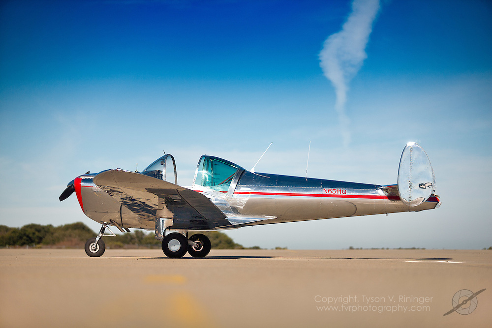 A highly polished 1966 Alon A2 Aircoupe, N6511Q, sits on the ramp at the Marina Municipal Airport in Marina, California.