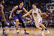 Feb 10, 2016; Phoenix, AZ, USA; Golden State Warriors guard Klay Thompson (11) handles the ball against Phoenix Suns guard Devin Booker (1) at Talking Stick Resort Arena. The Golden State Warriors won 112-104. Mandatory Credit: Jennifer Stewart-USA TODAY Sports