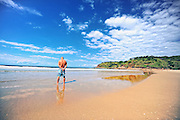 A man thinking if he should go in to the cool water or not. Australian beach NSW.