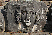 Giant Gorgon head, possibly Medusa, 2nd century AD, from the Temple of Apollo, 4th century BC, Didyma, Aydin, Turkey. The Gorgons were 3 sisters (Medusa, Stheno and Euryale) with snakes for hair, who could turn people to stone. They are patrons of secrecy, protecting the mystery of the oracle, and their faces were here used as a charm against illness. Didyma was an ancient Greek sanctuary on the coast of Ionia near Miletus, consisting of a temple complex and the oracle of Apollo, or Didymaion, who was visited by pilgrims from across the Greek world. The earliest temple ruins found here date to the 8th century BC but Didyma's heyday lasted throughout the Hellenistic age. It was approached along a 17km Sacred Way from Miletus and is the largest sanctuary in Western Turkey. Picture by Manuel Cohen
