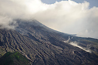 Smoke and clouds on the summit of Gunung Merapi from Kinahrejo, Java, Indonesia.