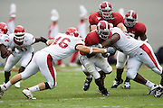 Alabama Crimson Tide running back Kenneth Darby gets tackled by Arkansas Razorback linebacker Clarke Moore during a 24 to 13 win over the Razorbacks on September 24, 2005 at Bryant-Denny Stadium in Tuscaloosa, Alabama..Mandatory Credit: Wesley Hitt/Icon SMI