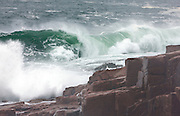 The granite rocks of the well known Thunder Hole region of Acadia National Park receives the full brunt of a nor'easter. A popular location for photographers and tourists alike.