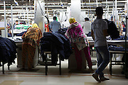 Garment workers ironing clothes inside Epyllion Group garment factory in Bangladesh.