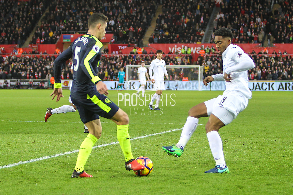Gabriel of Arsenal and Leroy Fer of Swansea City during the Premier League match between Swansea City and Arsenal at the Liberty Stadium, Swansea, Wales on 14 January 2017. Photo by Andrew Lewis.