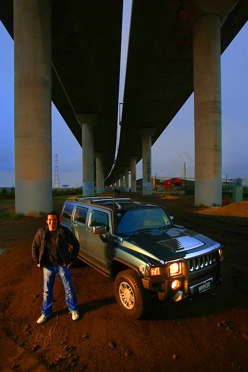Peter Tripatgis under the Bolte Bridge with his Hummer which he says he will drive no matter what the price of petrol  Pic By Craig Sillitoe  14/06/2008 SPECIALX 000 melbourne photographers, commercial photographers, industrial photographers, corporate photographer, architectural photographers, This photograph can be used for non commercial uses with attribution. Credit: Craig Sillitoe Photography / http://www.csillitoe.com<br /> <br /> It is protected under the Creative Commons Attribution-NonCommercial-ShareAlike 4.0 International License. To view a copy of this license, visit http://creativecommons.org/licenses/by-nc-sa/4.0/.