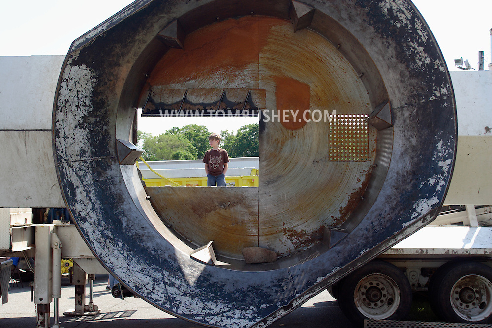 """Goshen, NY - A little boy looks over a large piece of heavy machinery on display at the """"Touch a Truck"""" event"""
