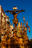 A paso (float) of The Crucifixion of Jesus Christ in the procession of the Brotherhood (Hermandad) San Benito, Holy Week (Semana Santa), Seville, Andalusia, Spain.