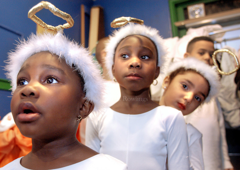 Angels in Waiting-- Nilsa Pedanou, 4, left, her sister Nilka Pedanou, 6, and Taysha Quinonez, 5, wait backstage before performing in the annual Three Kings Day celebration in the Villa Victoria neighborhood of Boston.