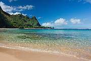 Clear ocean water on the beach amd Bali Hai (Makana) ridge from Tunnels Beach, Kauai, Hawaii