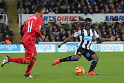 Newcastle United's Midfielder Vurnon Anita passes the ball  during the Barclays Premier League match between Newcastle United and Liverpool at St. James's Park, Newcastle, England on 6 December 2015. Photo by George Ledger.