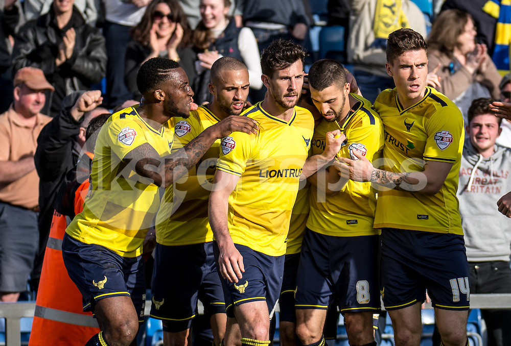 Liam Sercombe of Oxford United celebrates with teammates during the Sky Bet League 2 match between Oxford United and Stevenage at the Kassam Stadium, Oxford, England on the 25th March 2016. Photo by Liam McAvoy.