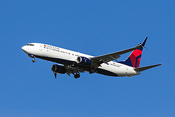 Delta Airlines Boeing 737-932ER (registration N843DN) approaches San Francisco International Airport (SFO) over San Mateo, California, United States of America
