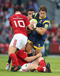 Rory Scannell of Munster Rugby tackles Max Stelling of Worcester Warriors<br /> <br /> Mandatory by-line: Cathal Noonan/JMP - 26/8/2016 - RUGBY - Irish Independent Park - Cork, - Munster v Worcester - Pre-Season Friendly