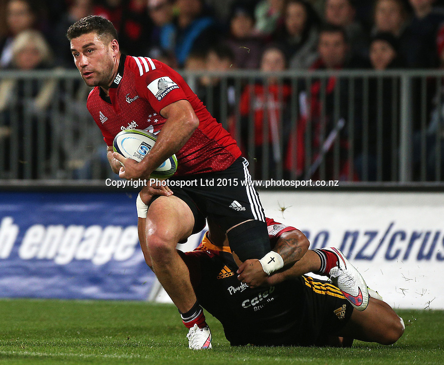 Kieron Fonotia of the Crusaders tackled during the Investec Super Rugby game between the Crusaders v Chiefs at AMI Stadium in Christchurch. 17 April 2015 Photo: Joseph Johnson/www.photosport.co.nz