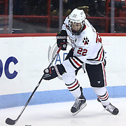 Tanner Pond #22 of the Northeastern Huskies controls the puck during the game at Matthews Arena on January 18, 2014 in Boston, Massachusetts. (Photo by Elan Kawesch)