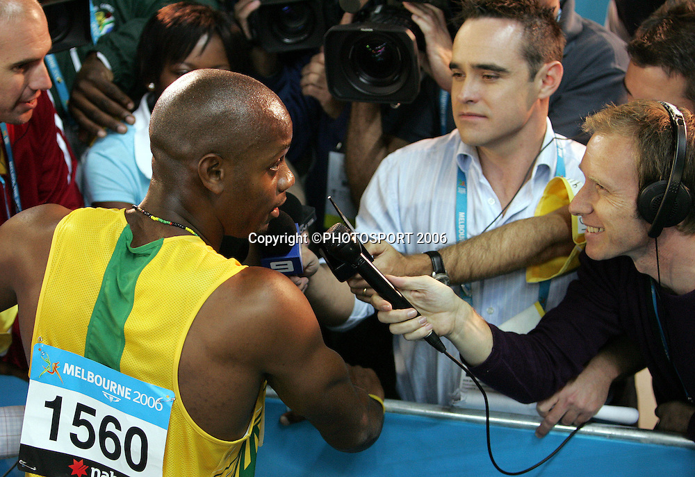 Jamaican athlete Asafa Powell (JAM) talks to the press after winning the Men's 100M sprint on Day 5 of the XVIII Commonwealth Games at the MCG, Melbourne, Australia on Monday 20 March, 2006. Photo: Hannah Johnston/PHOTOSPORT<br /><br />150692 interview interviewing media jamaica
