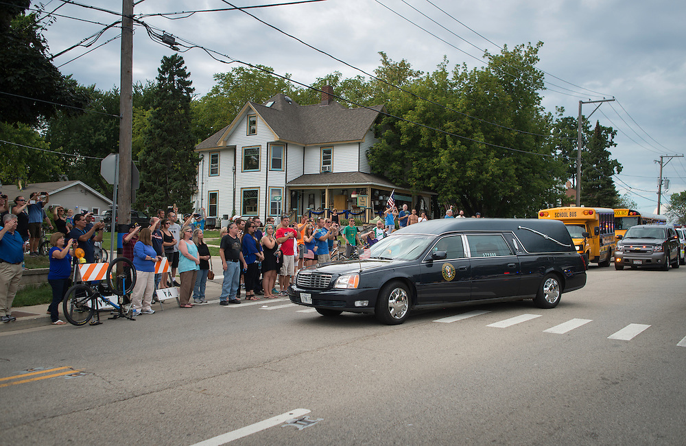 Photo by Michael R. Schmidt  Antioch, IL September 7, 2015<br /> Memorial services for Police Lieutenant Charles Joseph Gliniewicz were held at  Antioch Community High School on Monday, September 7, 2015. Gliniewicz, a 30-year veteran was shot and killed last week in the line of duty.
