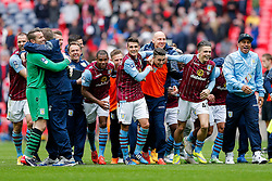 Players including Shay Given, Ashley Westwood and Jack Grealish celebrate after Aston Villa win the match 2-1 to reach the 2015 FA Cup Final - Photo mandatory by-line: Rogan Thomson/JMP - 07966 386802 - 19/04/2015 - SPORT - FOOTBALL - London, England - Wembley Stadium - Aston Villa v Liverpool - FA Cup Semi Final.