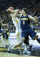 January 14, 2011: Iowa Hawkeyes guard Matt Gatens (5) is fouled by Michigan Wolverines guard Stu Douglass (1) during the NCAA basketball game between the Michigan Wolverines and the Iowa Hawkeyes at Carver-Hawkeye Arena in Iowa City, Iowa on Saturday, January 14, 2011. Iowa defeated Michigan 75-59.