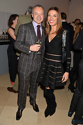 GRAHAM NORTON and HEATHER KERZNER at a private view of photographs by David Bailey entitled 'Bailey's Stardust' at the National Portrait Gallery, St.Martin's Place, London on 3rd February 2014.