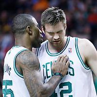 29 March 2013: Boston Celtics shooting guard Terrence Williams (55) taks to Boston Celtics power forward Shavlik Randolph (42) during the Boston Celtics 118-107 victory over the Atlanta Hawks at the TD Garden, Boston, Massachusetts, USA.