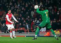Photo: Tom Dulat/Sportsbeat Images.<br /> <br /> Arsenal v Steaua Bucharest. UEFA Champions League. 12/12/2007.<br /> <br /> Denilson of Arsenal misses shot on target. Robinson Zapata of Steaua Bucharest saves the ball.