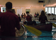 """Couples look on as other participants in the """"Love Boat"""" event paddle around the pool in Norris Aquatic Center on February 14, 2015. Photo by Lauren Pond"""