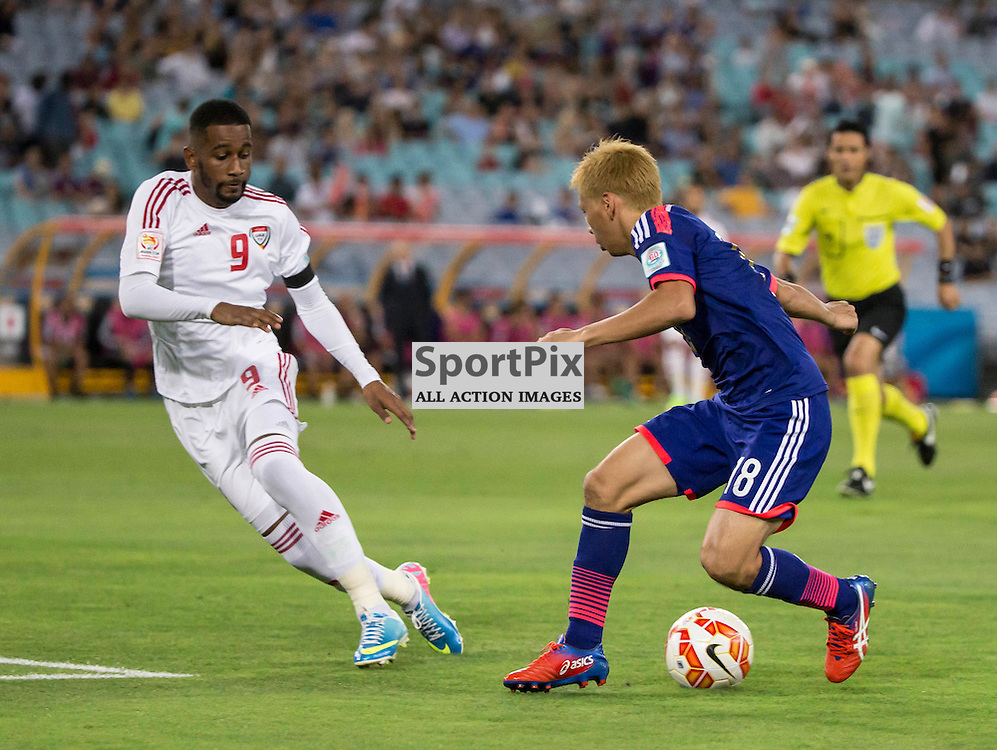 AFC Asian Cup Quarter Final, Japan v UAE; ANZ Stadium; 23rd January 2015<br /> Japan&rsquo;s Forward TAKASHI INUI tries to get around United Arab Emirates Defender Abdulaziz Haikal