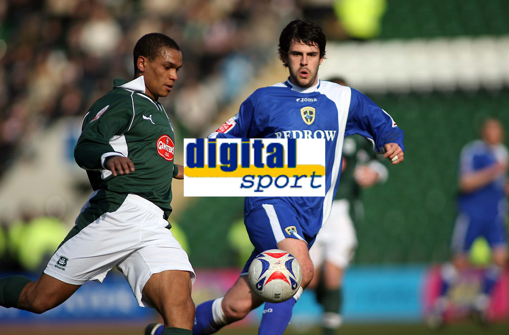 Plymouths Mathias Kouo-Doumbe clears whilst watched by Cardiff goalscorer Steven Thompson<br /> <br /> Photo: Richard Eaton.<br /> <br /> Plymouth Argyle v Cardiff City. Coca Cola Championship. 18/03/2006.
