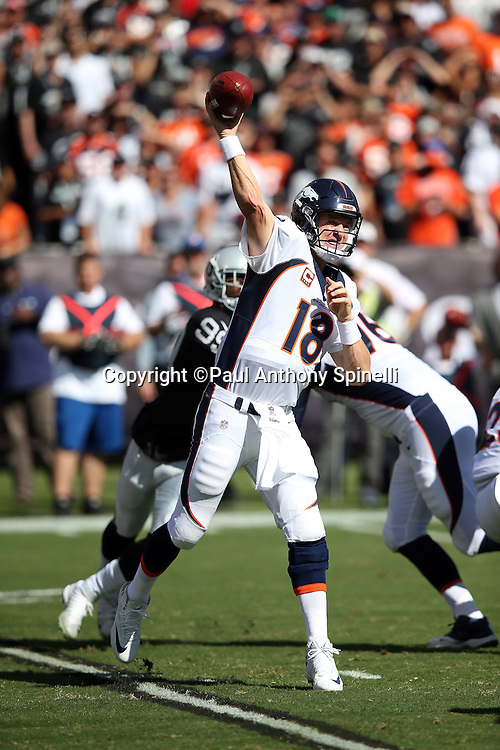 Denver Broncos quarterback Peyton Manning (18) grimaces as he throws a second quarter pass during the 2015 NFL week 5 regular season football game against the Oakland Raiders on Sunday, Oct. 11, 2015 in Oakland, Calif. The Broncos won the game 16-10. (©Paul Anthony Spinelli)