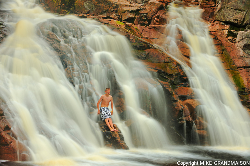 Boy in waterfall. Mary Ann Falls. MOdel released <br />