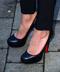 In the frame - shoes of Tulisa Contostavlos who appears at Westminster Magistrates Court in London,  Thursday, 19th December 2013. Picture by Nils Jorgensen / i-Images