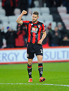 AFC Bournemouth defender Simon Francis pumps the air after the final whistle to celebrate Bournemouth's win over Norwich the Barclays Premier League match between Bournemouth and Norwich City at the Goldsands Stadium, Bournemouth, England on 16 January 2016. Photo by Graham Hunt.