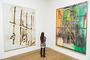 Hunting Tower and Watchtower - Alibis a Sigmar Polke retrospective at the Tate Modern – he was viewed as one of the most experimental artists of recent times and the exhibition covers his full career, bringing together works from around the world in a huge variety of materials. Highlights include: Girlfriends – An iconic early Pop painting from 1965 of a bikini-clad girl; Potato House – Standing over 6 feet tall, this sculpture of a house is made from wooden lattices covered in real potatoes; Mao – A huge felt banner covered in scraps of cloth and painted with an image of Chairman Mao; Watchtowers – A series of neon-coloured paintings incorporating silver, resin, fabric and bubble-wrap; and other paintings made from such diverse materials as meteorite dust, soot, lead, coal, elastic bands and medical tape. The exhibition runs from 9 October 2014 – 8 February 2015.  Tate Modern, Bankside, London, UK 07 Oct 2014.