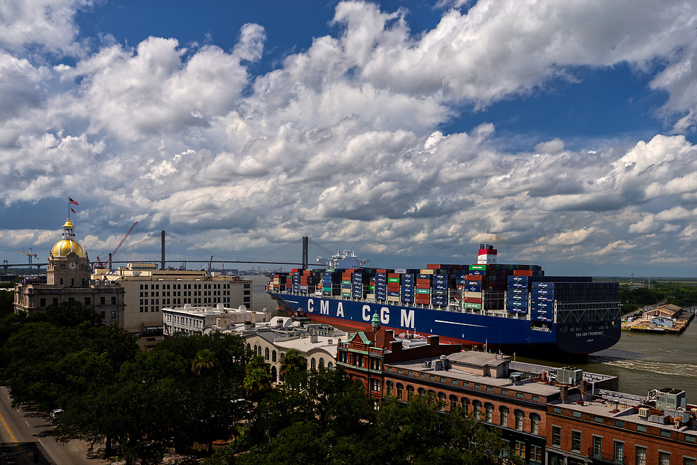 The 14,000 TEU container ship CMA CGM Theodore Roosevelt sails up river past Historic River Street to the Port of Savannah, Friday, Sept., 1, 2017, Savannah, Ga.  (GPA Photo/Stephen Morton)