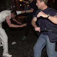 Police arresting football fan in Charleroi, Brussels.