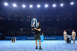 Andy Murray poses with the trophy after winning the championship during day eight of the Barclays ATP World Tour Finals at The O2, London.