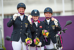 L-R Britta Napel (GER, Silver), Natasha Baker (GBR, Gold) and Angelika Trabert (GER, Bronze)<br /> Individual Championship Test  - Grade II <br /> London 2012 Paralympic Games<br /> © Hippo Foto - Jon Stroud