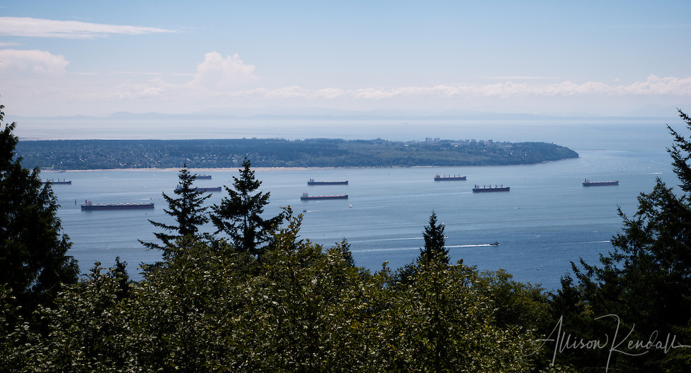 Ships wait at anchor in the waterways outside of Vancouver, BC