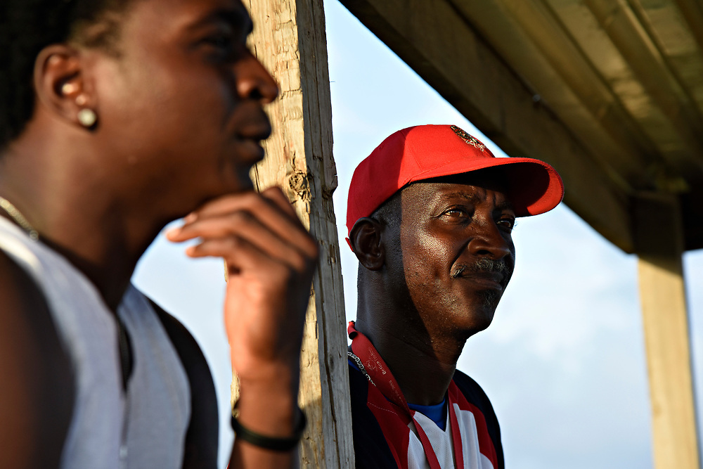 """WILLEMSTAD, CURACAO - DECEMBER 10, 2014:  Didi Gregorius, left, was just signed by the Yankees to be Derek Jeter's replacement. His father Johannes """"Didi"""" Gregorius, right, was a pitcher for the Amsterdam Pirates. (photo by Melissa Lyttle)"""