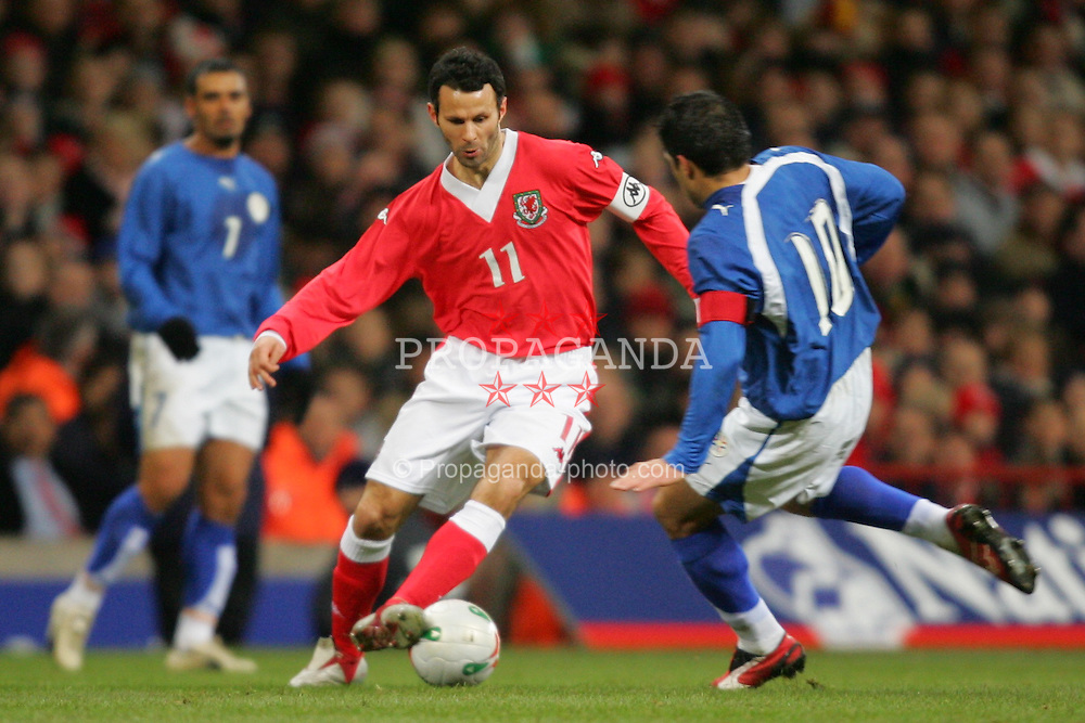 CARDIFF, WALES - WEDNESDAY, MARCH 1st, 2006: Wales' Ryan Giggs and Paraguay's Roberto Acuna during the International Friendly match at the Millennium Stadium. (Pic by Chris Brunskill/Propaganda)