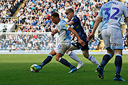 Blackburn Rovers Elliott Bennett shields the ball from Leeds United forward Jack Clarke (47) during the EFL Sky Bet Championship match between Blackburn Rovers and Leeds United at Ewood Park, Blackburn, England on 20 October 2018.