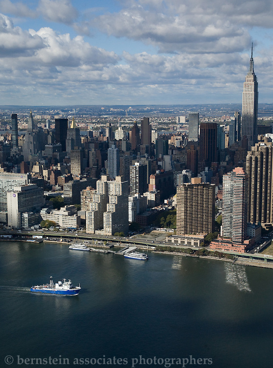 Empire State Building Aerial Photo with a tug boat in the East River.
