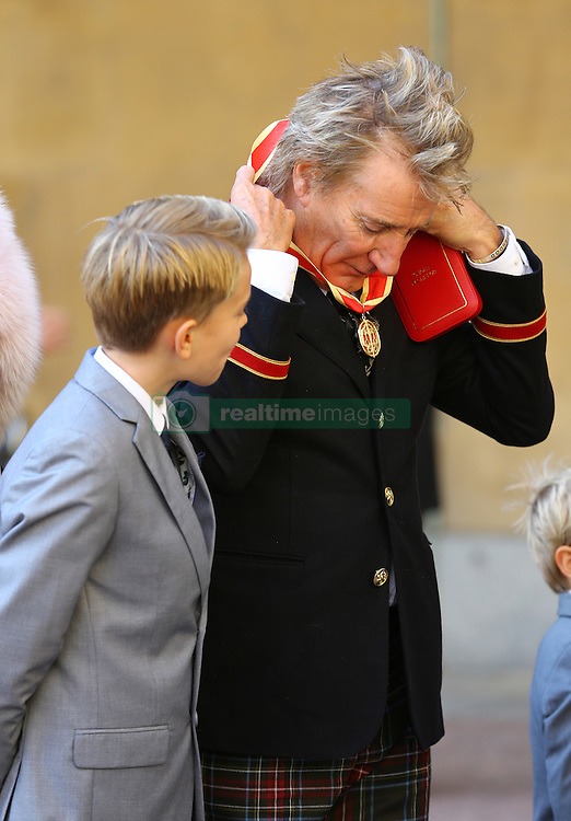 Veteran singer Sir Rod Stewart at Buckingham Palace in London, with his son Alastair after he received his knighthood in recognition of his services to music and charity.
