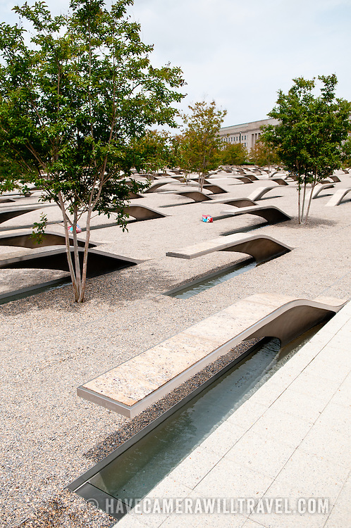 The Pentagon Memorial is in remembrance of the events of September 11, 2001, and the 184 people who died as victims of the terrorist attack on the Pentagon. The Memorial is adjacent to the southwest side of the Pentagon. Designed by Julie Beckman and Keith Kaseman, the memorial opened to the public on September 11, 2008, it is designed with one illuminated for each victim of the attack, arranged by the person's age. Each bench has a small pond of water underneath, and a name is etched on the end of each bench.